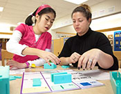 The Center School, Brachburg, NJ - femaile student and teacher working together