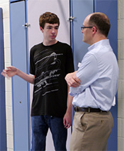 The Center School, Branchburg, NJ - teacher and male student talking in the hallway