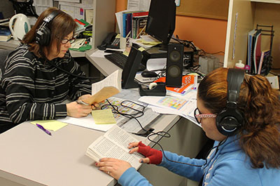 Female students woking on reading skills w headphones - private special education school in Somerset NJ