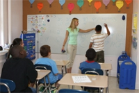 private special education school nj - Therapeutic School teacher with students in the classroom