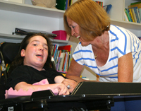 Matheny School student in power-chair and teacher - Alliance of Special Education Schools of North Jersey member