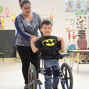 Student in Batman shirt with teacher at private special education school in Mountainside NJ